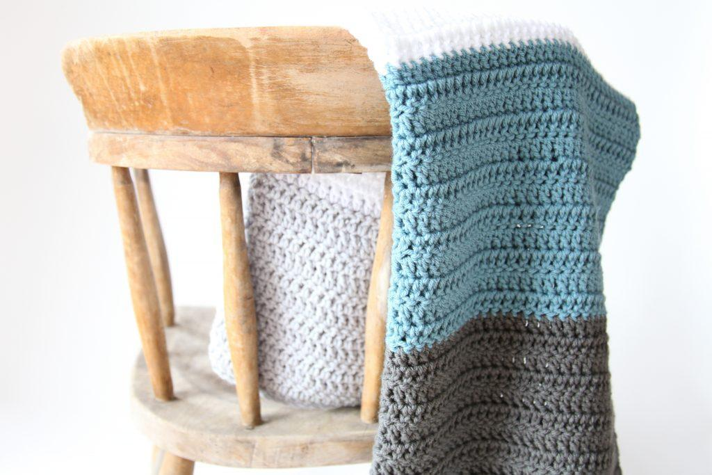 block stripe blanket on a rustic chair